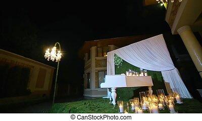 Beautiful wedding ceremony night candle piano moss