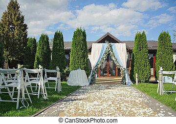 Beautiful wedding ceremony park rain
