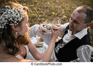 Beautiful wedding couple at a picnic under tree