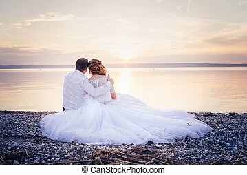 Beautiful wedding couple - Beautiful young wedding couple at...