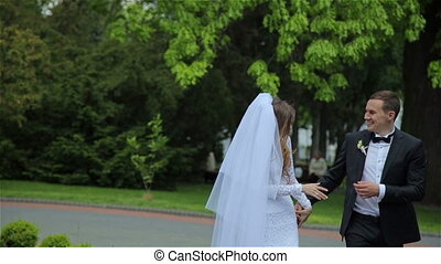 Beautiful wedding couple in the park