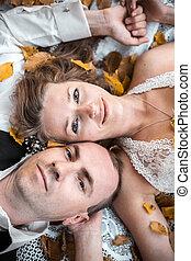 wedding couple lying under a tree