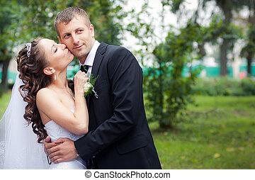 beautiful wedding couple - beautiful brunette bride in white...
