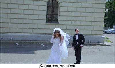 Beautiful wedding couple walking