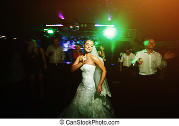 Beautiful wedding dance in soap bubbles, blurred