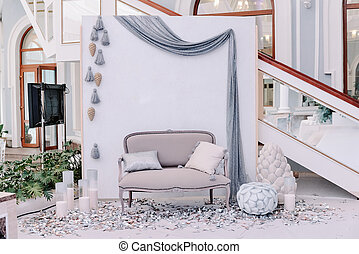 Beautiful wedding photo zone with small sofa