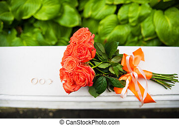 beautiful wedding rings and a bouquet of red roses