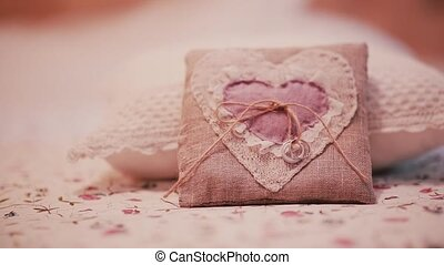 Beautiful wedding rings on a little pillow. Preparation for...