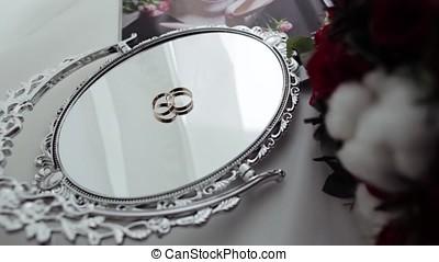 Beautiful wedding rings on a vintage mirror. wedding rings...