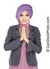 beautiful welcoming girl wearing hijab smiling isolated on...