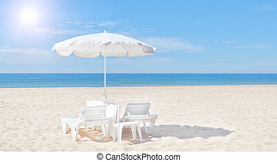 Beautiful white beach umbrella and sun bed on the beach. For...