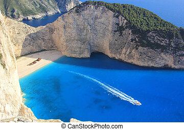 beautiful white beach with shipwreck in a greek island