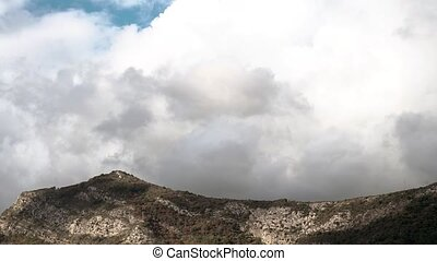 Cumulus Clouds Curling Over Green Hill - Beautiful White...