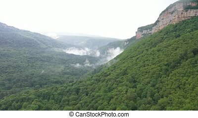 Beautiful white fog in the mountains in southern Russia -...