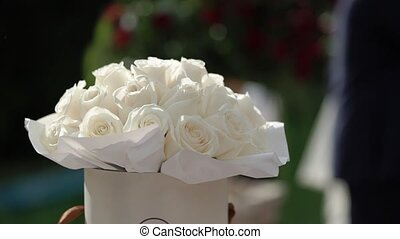 Beautiful white roses in a round box. Flowers in a round...