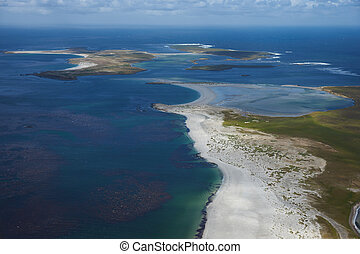 Beautiful white sandy beaches and clear blue waters of the Falkland Islands in the South Atlantic