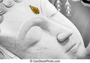 beautiful white sleeping peace buddha face.
