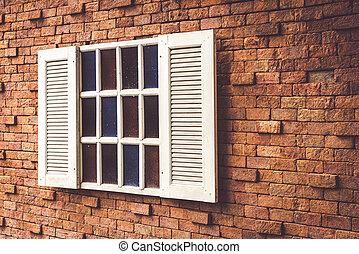 vintage window on brick wall