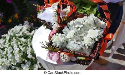Beautiful white wedding decorations flowers in basket.