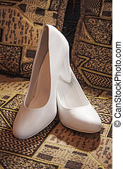 Beautiful white wedding shoes for the bride