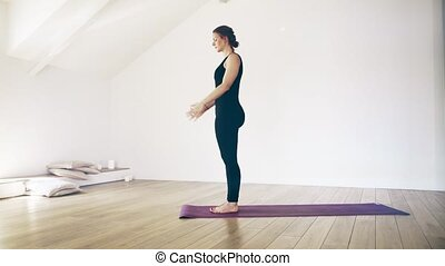 Beautiful white woman doing yoga indoors