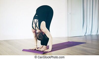 Beautiful white woman doing yoga inside