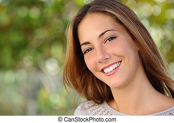 Beautiful white woman smile dental care concept with a green background