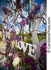 Beautiful whitel floral sign decoration at wedding aisle
