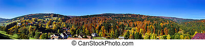 Beautiful wide panoramic view of autumn hills