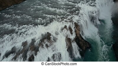 Beautiful wild waterfall Gullfoss from the copter. Aerial...