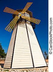Beautiful windmill landscape with blue sky.