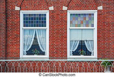 Beautiful windows of a brick house.
