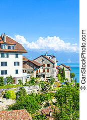 Beautiful winemaking village Rivaz in Swiss Lavaux wine region. Buildings located by the stunning Lake Geneva. Natural landscape in Switzerland. European travel destination
