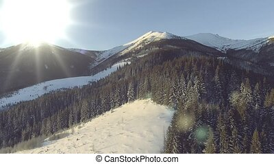 Beautiful Winter Aerial Flight Over Mountain Chain Landscape...