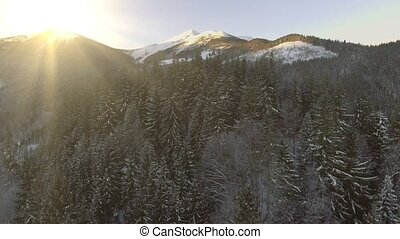 Beautiful Winter Aerial Flight Over Mountain Chain Landscape...