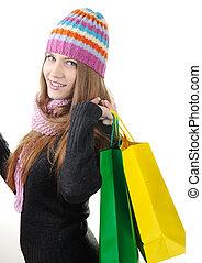 Beautiful winter girl with shopping bags