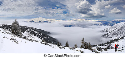 Beautiful winter landscape in the mountains with the sea of fog