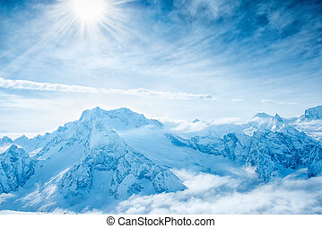 beautiful winter landscape of Dombaj mountains higher than clouds, close up, top veiw