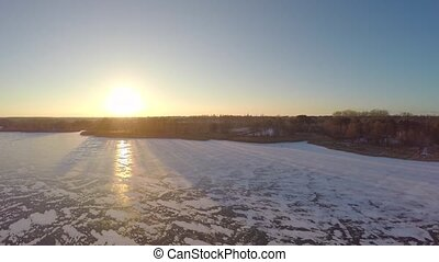 beautiful winter landscape of icy lake