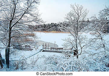 Beautiful winter landscape with a pier