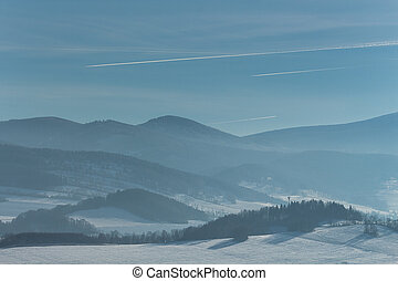 Beautiful winter landscape with fog in the mountains.