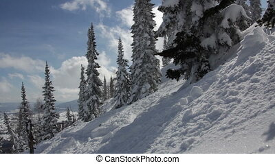 Beautiful winter landscape with snow covered trees in mountains time lapse
