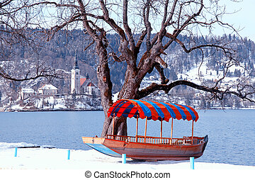 traditional Slovenian boat and church on Lake Bled, Slovenia