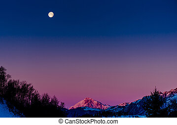 beautiful winter mountain landscape with moon