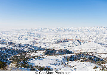 Beautiful winter panorama of the Tien Shan mountains in Uzbekistan in the Beldersay ski resort on a clear winter day