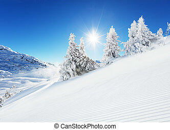 Beautiful winter slope in the mountains with blue sky and...