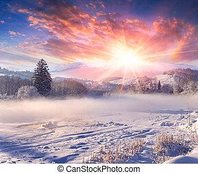 Beautiful winter sunrise in the mountain village.