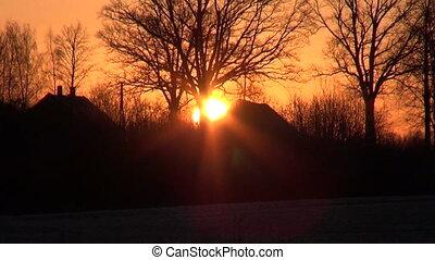 beautiful winter sunrise in village