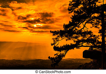Beautiful winter sunset at cliff in the nature, with silhouettes