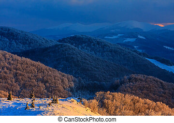 Beautiful winter sunset in the mountains, Bieszczady, Poland